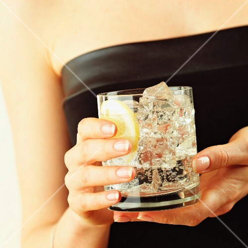 hand holding gin and tonic