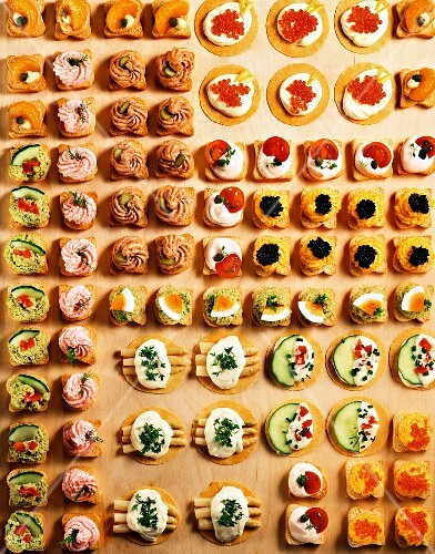 Lots of different canapés in rows