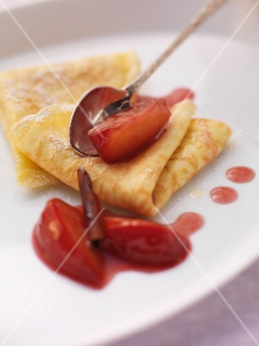 Pancakes with stewed plums