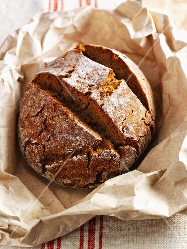 Hearty rye bread on brown paper