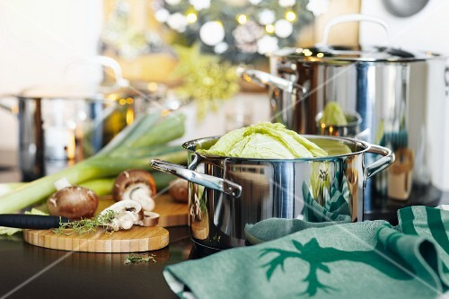 Preparations for a Christmas meal with savoy cabbage and button mushrooms