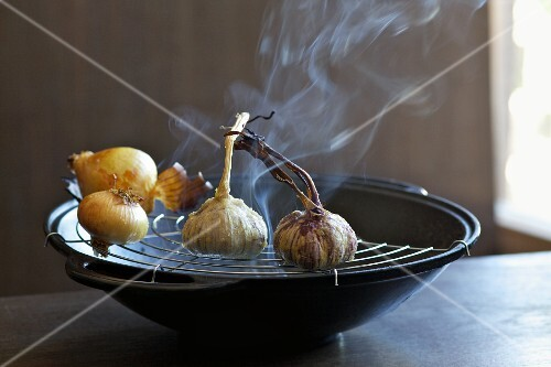 Onions and garlic being smoked