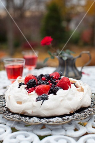 Pavlova Cake with Berries on an Outdoor Table