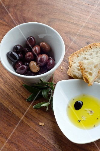 Olives, white bread, and olive oil with balsamic vinegar