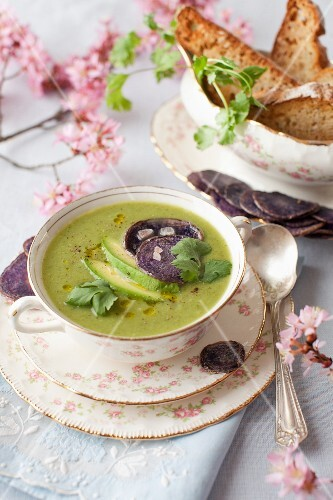 A Bowl of Spring Green Soup with Avocado and Beet Chips