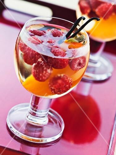 White wine with raspberries, vanilla and Japanese persimmon