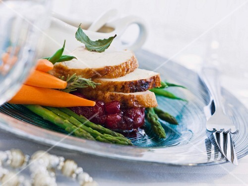 Turkey breast with cranberry compote and vegetables