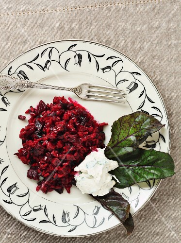 Beetroot risotto served with a blob of herb ricotta