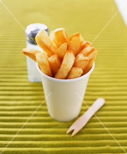Spicy chips in a cardboard cup