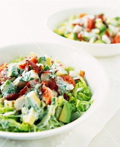 Cobb salad with avocado, tomatoes, bacon, chicken and Roquefort dressing