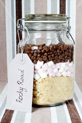 A preserving jar containing dry ingredients for making Rocky Road (chocolate and marshmallow cake, USA)