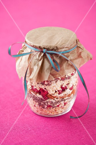 Muesli mix with dried raspberries in a jar
