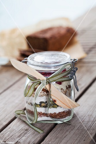 A jar containing dry ingredients for making soda bread with rye and cranberries
