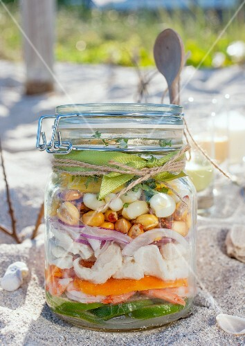 Ingredients for making ceviche, layered in a jar