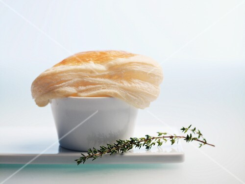Soup in a bowl with a puff pastry lid