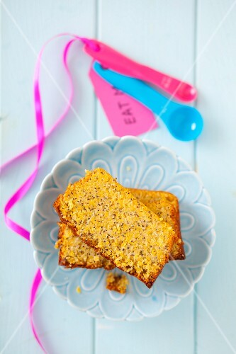 Two slices of gluten-free lemon cake with poppy seeds