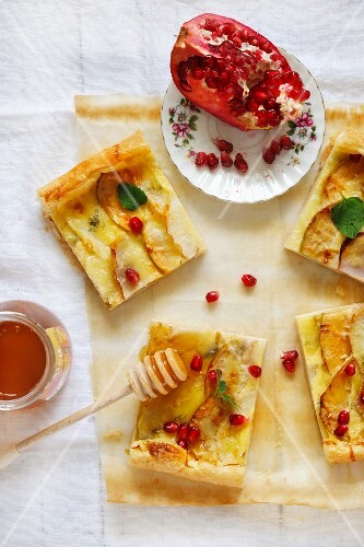 Turnip, apple and cheese toma tart with honey and pomegranat