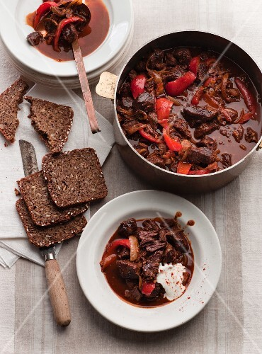 Beef goulash with sour cream and wholemeal bread