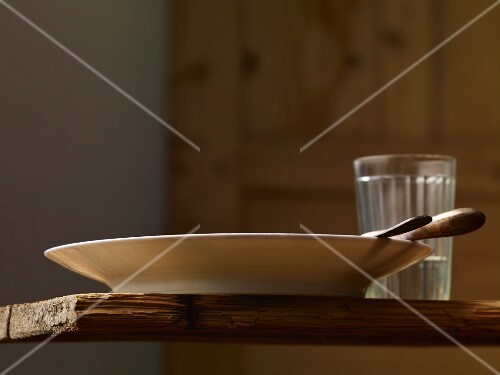A simple place setting on a rustic wooden table