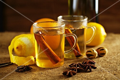 White Glühwein (German mulled wine) with spices and lemons