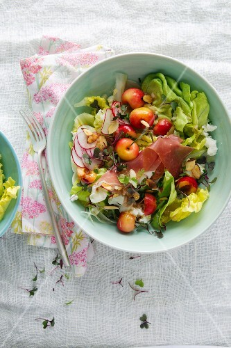 Mixed Green Salad with Fresh Cherries, Radishes and Prosciutto; In a Bowl