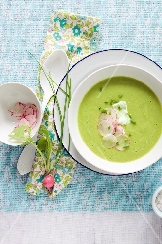 A Bowl of Pea Soup with Thinly Sliced Radish Garnish