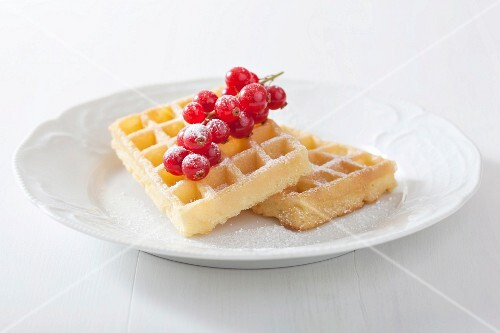 Waffles with redcurrants and icing sugar