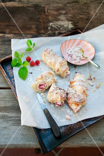Puff pastry rolls filled with berries and cream