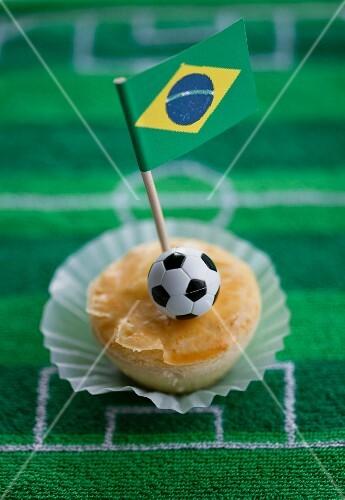 Empadinhas (small pies, Brazil) with a Brazilian flag