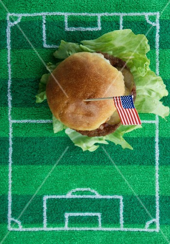 Hamburger with a US flag on a football-field mat