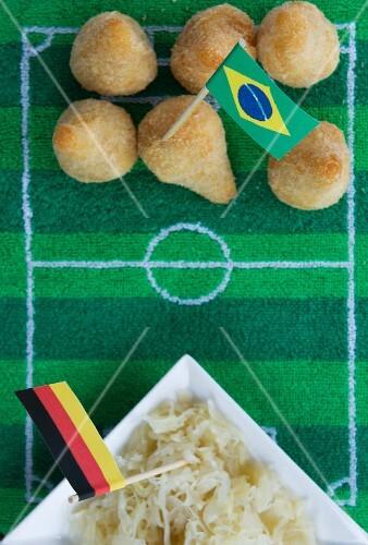 Salgadinhos (Brazil) and sauerkraut (Germany) with football-themed decoration