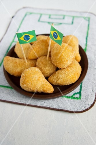 Salgadinhos (filled pastries, Brazil) with football-themed decoration