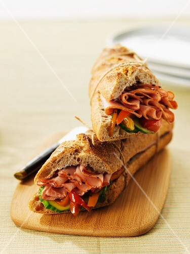 A baguette sandwich filled with pastrami
