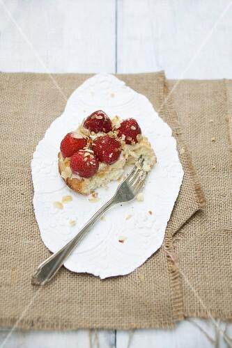 Mini sponge cake topped with custard and strawberries