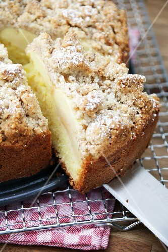 Apple streusel cake, one slice cut (close-up)