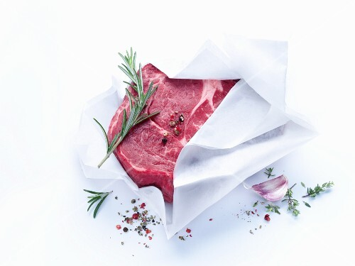 Fresh beef wrapped in paper with herbs and spices