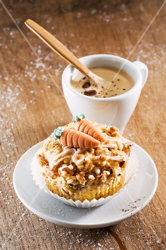 A carrot muffin with a cup of coffee