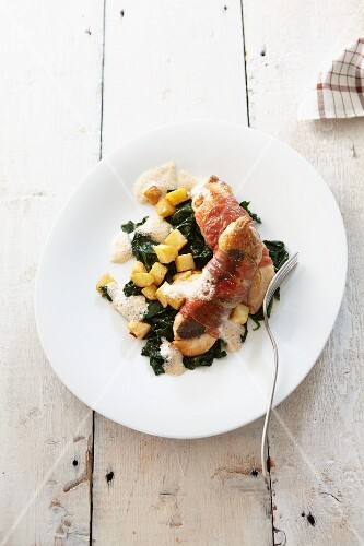 Guinea fowl wrapped in bacon with spinach