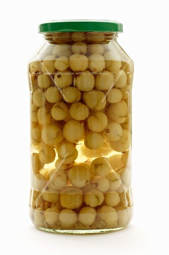 Preserved gooseberries in a screw-top jar