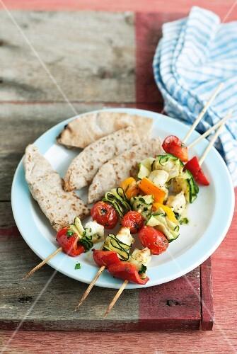 Marinated vegetable skewers with flatbread