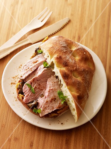 Sandwich filled with lamb and tagine-spiced butter