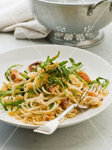 Spaghetti with crab, rocket, pancetta and breadcrumbs