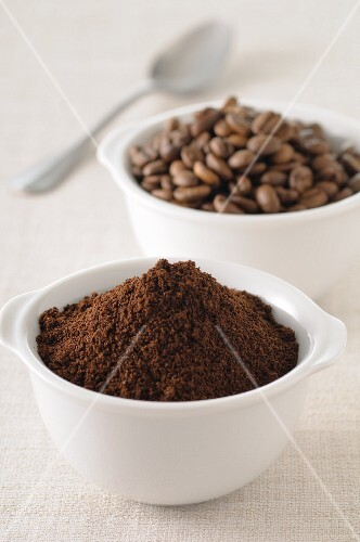 Coffee, whole beans and ground, in small bowls