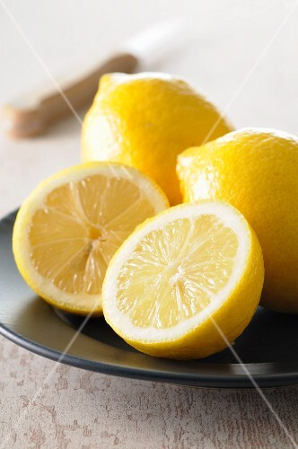 A whole lemon and a halved lemon