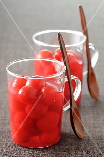 Stewed cherries in glass mugs