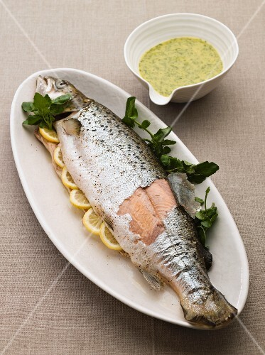 Poached sea trout with lemons and a herb sauce