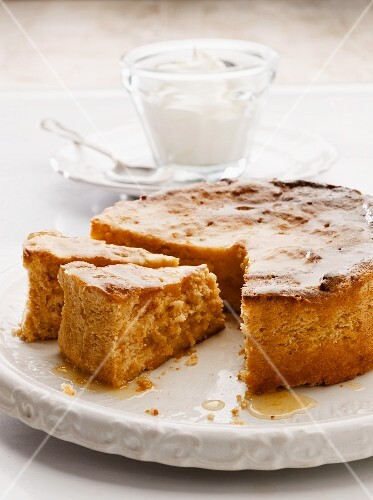 Orange and almond cake, partly sliced