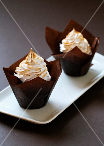 Chocolate muffins with meringue on the top