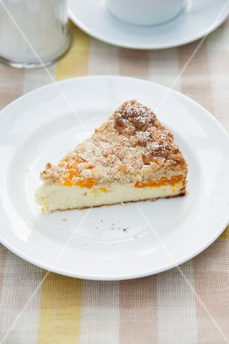 A slice of cheesecake with Mirabelle plums and crumble