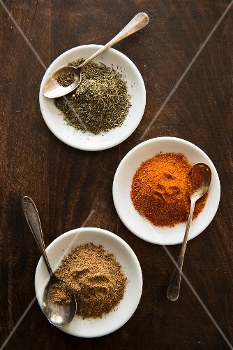 Three different spices in white dishes